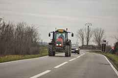 Tractor on highway stock photo