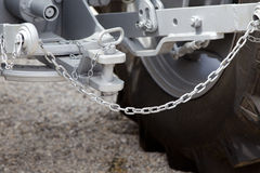 Tractor hitch and tow bar. Close up of new tractor hitch with tow bar and chains Royalty Free Stock Photos