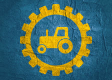 Tractor icon in gear Royalty Free Stock Images