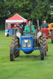 Tractor ID Parade. Oxfordshire Young Farmers county fair held near Spelsbury, Parade of vintage tractors Royalty Free Stock Image