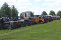 Tractor ID Parade. Oxfordshire Young Farmers county fair held near Spelsbury, Parade of vintage tractors Stock Image