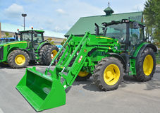 Tractor John Deere 640 R. SAINT HYACINTHE QC CANADA JULY 25 2015: Tractor John Deere 640 R. Deere & Company, the firm founded by John Deere, began to expand its Stock Photos