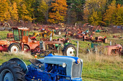 Tractor junkyard. A junkyard of old, abandoned, rusting farm tractors and heavy duty farming equipment Royalty Free Stock Photography