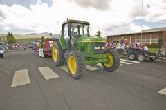 Tractor leading the Fourth of July parade down main street, in Lima Montana Stock Photos