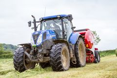 Tractor and lely baler Royalty Free Stock Photography