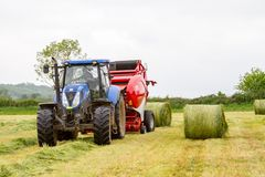 Tractor and lely baler Stock Photo