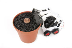 Tractor and Lithops pot. Bobcat tractor playing with Lithops pot Royalty Free Stock Images