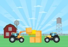 Tractor load hay bale in stack on farm. Rural agribusiness concept with tractor, windmill and barn, farmer working in field, growing and harvesting. Locally Royalty Free Stock Photo