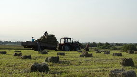 Tractor load people hay Royalty Free Stock Photography