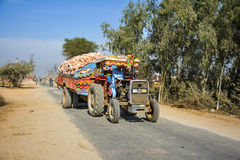 Tractor loaded with rock salt. A man driving tractor loaded with rock salt Stock Photos