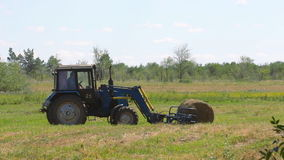 Tractor loading hay stock video footage