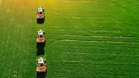 Tractor makes fertilizer on the field. Top view royalty free stock images