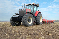 Tractor makes tillage Stock Photography
