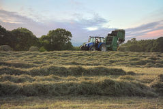Tractor making hay bails Stock Image