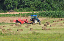 Tractor making hay bales Royalty Free Stock Photo