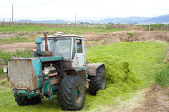 Tractor making silo pit. Tractor making bunker silo in outdated way royalty free stock photos