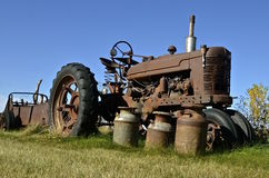 Tractor, manure spreader, and milk cans Royalty Free Stock Image