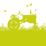 Tractor on meadow Stock Photos