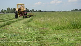Tractor in meadow stock video footage