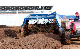 Tractor Mixing Manure Stock Photography