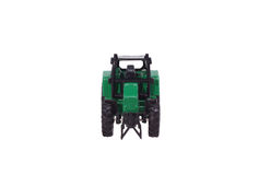 Tractor model. Children's toy. Royalty Free Stock Images
