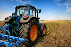 Tractor - modern agriculture equipment. Tractor on the farm - modern agriculture equipment in field