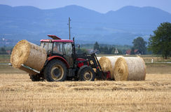 Tractor moving bales Royalty Free Stock Photo