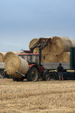 Tractor moving bales Royalty Free Stock Photos