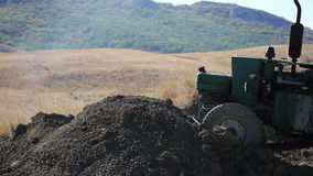 Tractor moving earth stock footage
