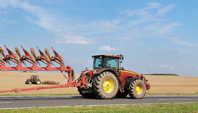 Tractor Moving Plough On The Road Royalty Free Stock Photos