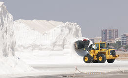 Tractor moving salt using a grab Royalty Free Stock Photo