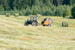 Tractor mowing grass Stock Images