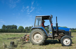 Tractor mowing green field stock photos