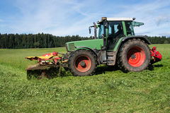 Tractor mowing meadow Stock Photography