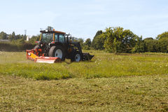 Tractor mows the lawn Royalty Free Stock Photography
