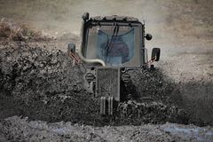 Tractor mud racing Royalty Free Stock Image