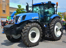Tractor New Holland T7 Series T7.230. SAINT HYACINTHE QC CANADA JULY 25 2015: Tractor New Holland T7 Series T7.230. New Holland Machine Company was founded in Royalty Free Stock Image