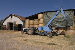 Tractor next to the farm Stock Photography