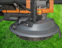 Mechanism for cutting lawns. Tractor nozzle gray for cutting grass on lawns Stock Images
