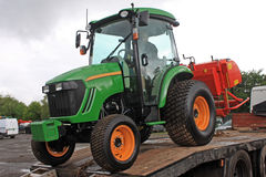 Tractor offloading Stock Photo