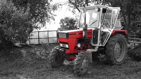 Tractor. Old red tractor in countryside Royalty Free Stock Photography
