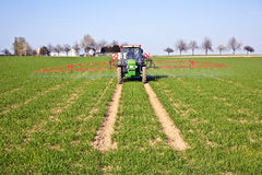 Free Tractor On Field Sputtering Pest Protection Royalty Free Stock Photography - 31970347