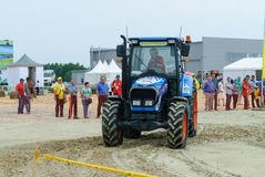 Tractor operator on special track for slalom Royalty Free Stock Images
