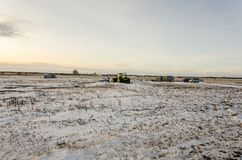 Tractor and other agricultural machinery in the snow-covered fie Royalty Free Stock Photography