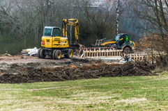 Tractor and other machinery operating on a construction site. A tractor and other construction machinery operating to build an upcoming raliway track Royalty Free Stock Photography