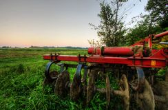 A tractor parked on grass. A tractor parked on an open field Royalty Free Stock Photography