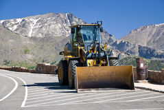 Tractor parked in the Rocky Mountains Royalty Free Stock Photo