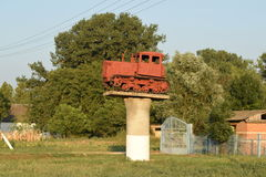 Tractor on a pedestal. Russia, Temryuk - 15 July 2015: Tractor on a pedestal. Monument agricultural machinery Royalty Free Stock Image