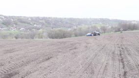 Tractor with planter. Turn around and lower it stock footage