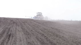 Tractor with planter. Turn and goes to the horizon stock video